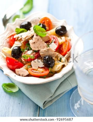 Pasta salad with cherry tomatoes and tuna - stock photo