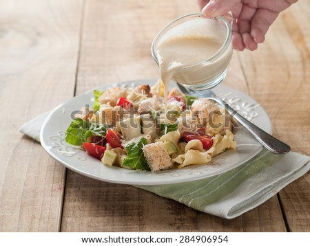 Pasta salad with chicken, tomato, cheese and sauce, selective focus - stock photo