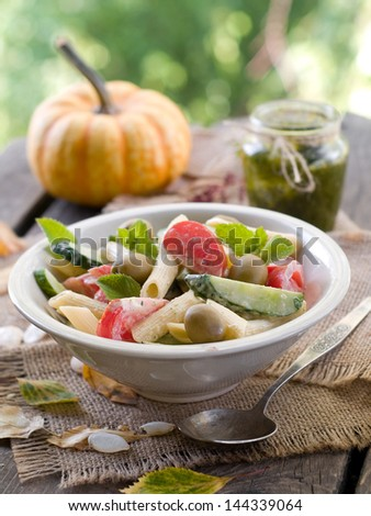 Pasta salad with cucumber, tomato and olives, selective focus - stock photo