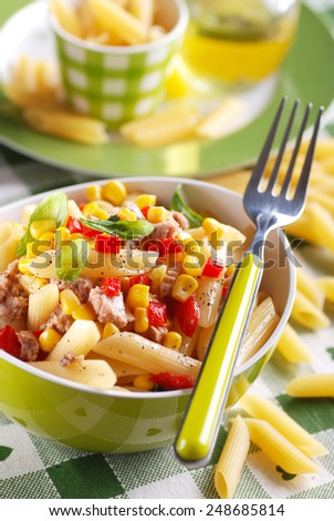 pasta salad with tuna and corn in green bowl