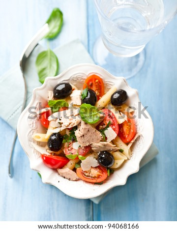Pasta salad with tuna, cherry tomatoes and olives - stock photo