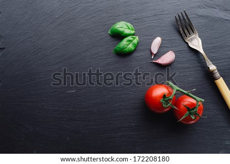 Pasta sauce ingredients concept on black slate background viewed from top - stock photo