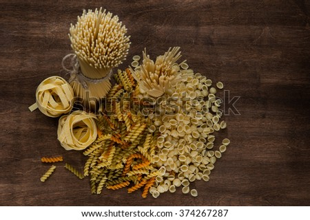Pasta set on the dark wooden background