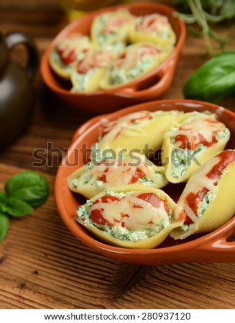 Pasta shells stuffed with ricotta cheese and spinach - stock photo
