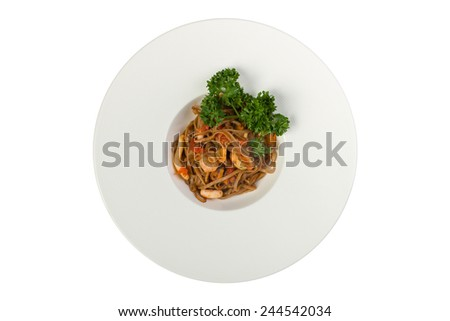 Pasta soba with seafood isolated on white background. Top view - stock photo
