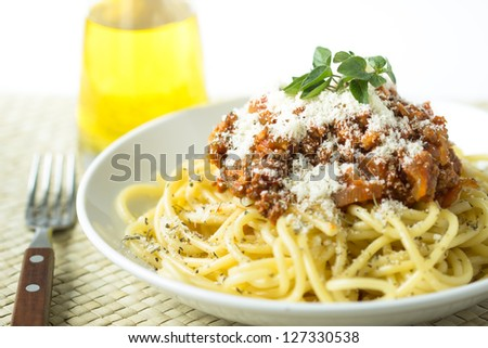 pasta spaghetti bolognese with tomato and meat sauce and Parmesan cheese - stock photo