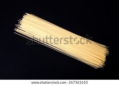 Pasta spaghetti on a black background. Selective focus. Space for text. - stock photo