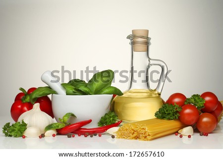 Pasta spaghetti, vegetables, spices and oil - stock photo