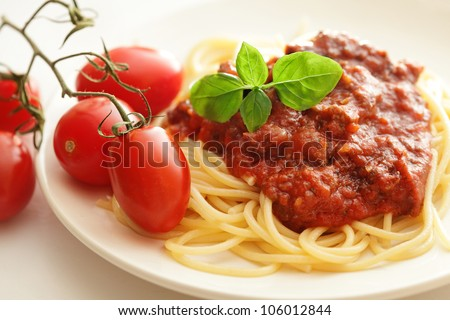 Pasta spaghetti with bolognese sauce and basil - stock photo