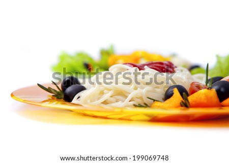 Pasta spaghetti with cherry tomato and salad - stock photo