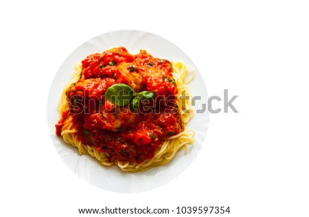 pasta spaghetti with meatballs in tomato sauce on a plate isolated on white background. with copy space. top view