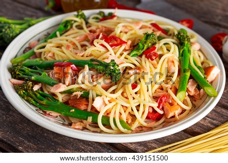 Pasta spaghetti with smoked salmon, chilli and broccoli. - stock photo
