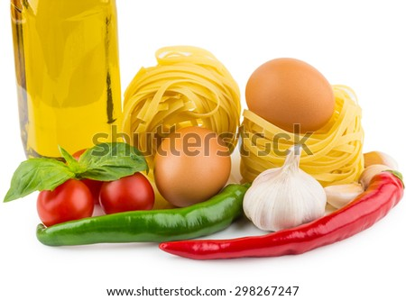 Pasta tagliatelle, bottle of olive oil, tomatoes, garlic, chili pepper and basil leaves isolated on white background