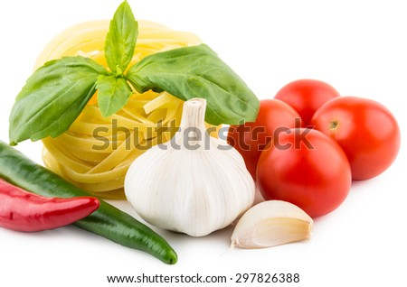 Pasta tagliatelle, tomatoes, garlic, chili pepper and basil leaves - stock photo