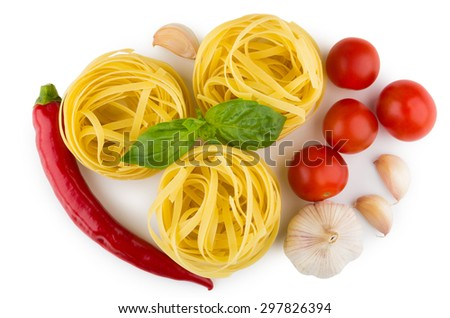 Pasta tagliatelle, tomatoes, garlic, chili pepper and basil leaves, top view - stock photo