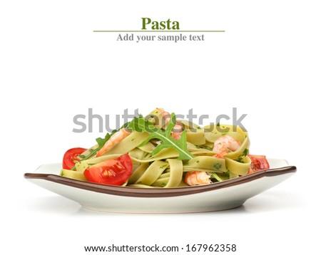 Pasta tagliatelle with shrimp and arugula - stock photo