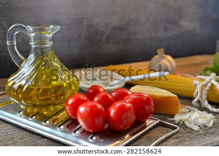 Pasta tomato parmesan on a wood background