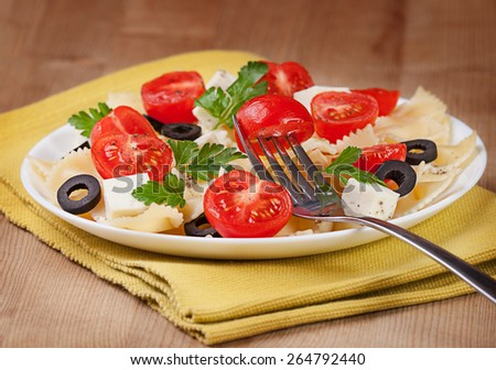 Pasta tomatoes, cheese on a plate - stock photo