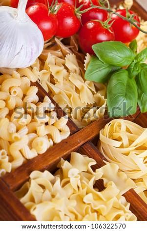 Pasta varieties with specific seasoning ingredients - closeup - stock photo