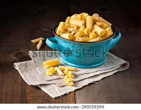 Pasta, variety of raw artisan made Italian pasta Tortiglioni, Penne, Rigatoni, toned image, selective focus - stock photo