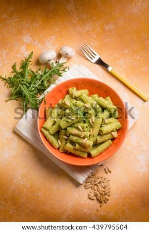 pasta with arugula pesto - stock photo