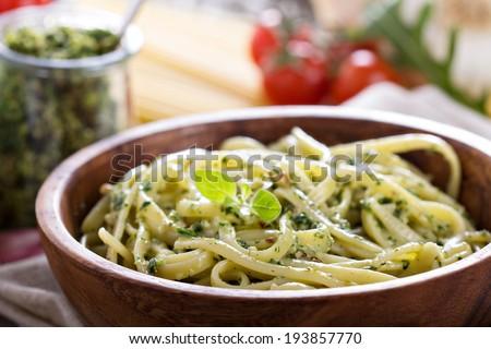 Pasta with arugula walnut pesto in a bowl - stock photo