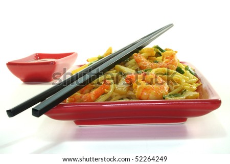 Pasta with asian shrimp in asian dishes