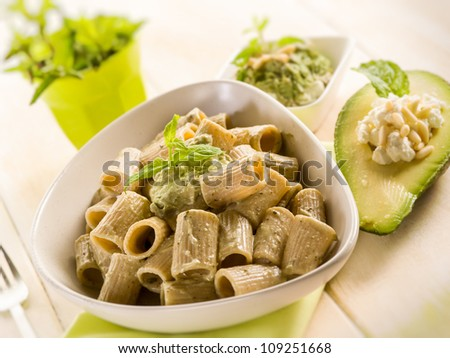 pasta with avocado mint and pine nuts pesto - stock photo