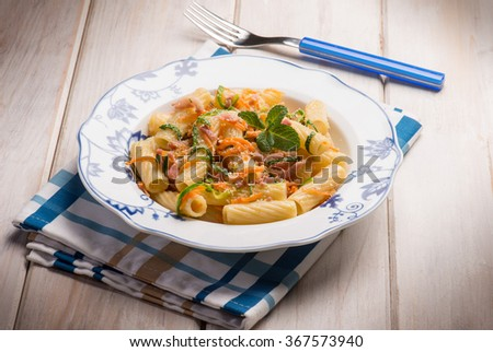 pasta with bacon carrot and leek - stock photo