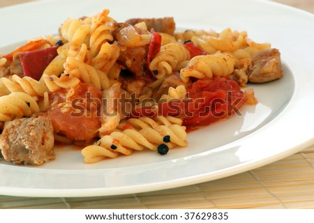 Pasta with baked tomato and chicken meat