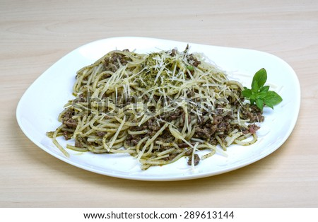 Pasta with beef, pesto sauce and cheese - stock photo