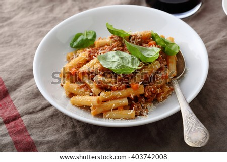 pasta with bolognese sauce and cheese, food close-up - stock photo