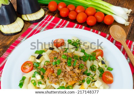 Pasta with bolognese sauce and eggplant, tomato