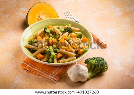 pasta with broccoli and pumpkin - stock photo