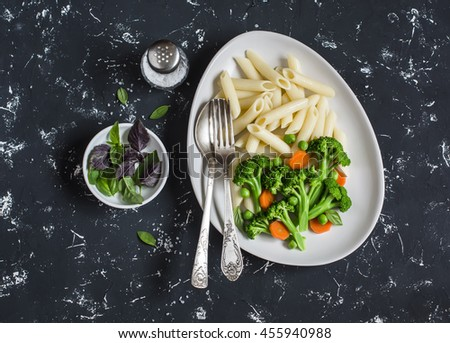 Pasta with broccoli. Delicious healthy vegetarian lunch. On a dark background - stock photo