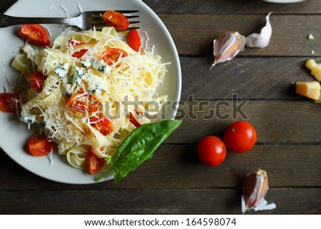 pasta with cheese and tomatoes, top view, food - stock photo
