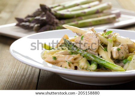 pasta with chicken and asparagus - stock photo