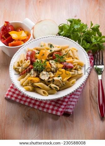 pasta with chicken and capsicum - stock photo