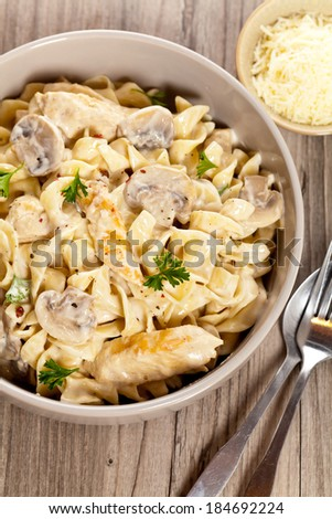 Pasta with chicken and cream mushroom sauce - stock photo