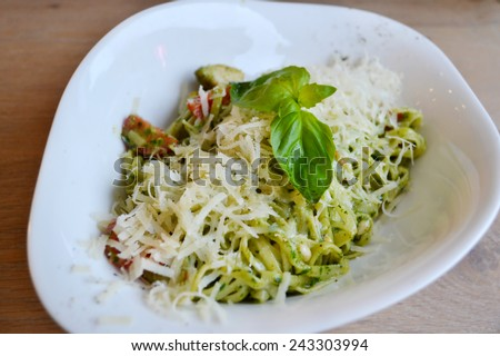 Pasta with chicken, cheese and pesto sauce - stock photo