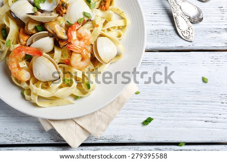 Pasta with delicious shrimp, food top view - stock photo