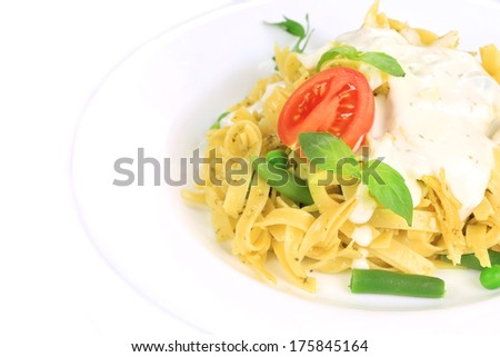 Pasta with dressing and green beans. Whole background.