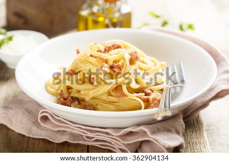 Pasta with egg sauce and ham - stock photo