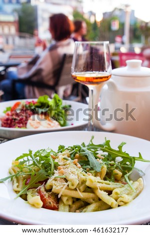 pasta with fresh arugula salad and pine nuts
