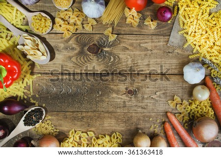 Pasta with fresh vegetables on the table