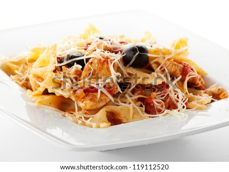 Pasta with Fried Fillet of Chicken and Tomato Sauce - stock photo