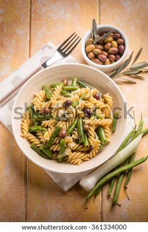 pasta with green beans and black olives - stock photo