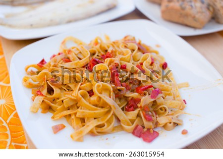 Pasta with meat on white plate. - stock photo
