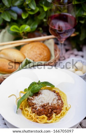 Pasta with meat, prunes and cheese in a plate