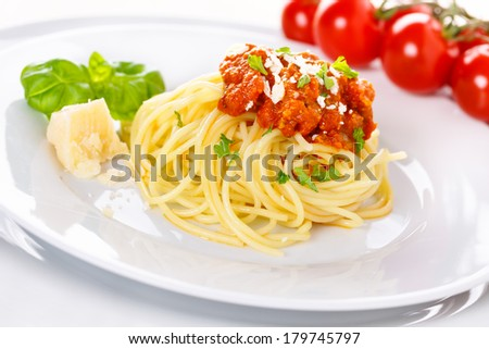 Pasta with meat sauce. Served with parmesan and basil